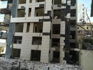 Beirut building facade shattered by force of explosion