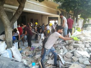 Civil Defense volunteers clear Beirut rubble far away from blast centre