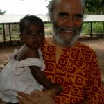 Dada Daneshananda and a baby who was born free from HIV